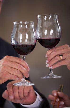 Happy Mature Couple Toasting Wine In A Elegant Restaurant photo