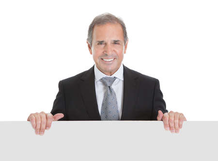 Portrait Of Happy Business Man Holding Blank Placard On White Background photo
