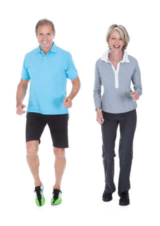 woman jogging: Happy Mature Couple Jogging Over White Background
