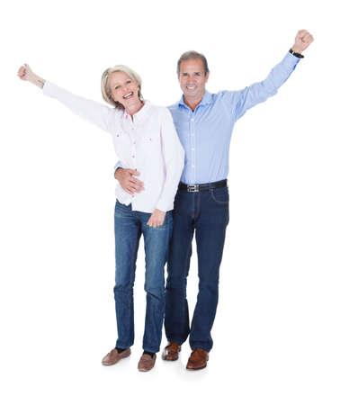 happy couple white background: Happy Mature Lovely Couple Enjoying Success Isolated Over White Background