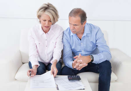 income tax: Mature couple doing family finances at home