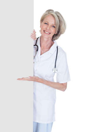 Female Doctor Holding Placard Over White Background photo