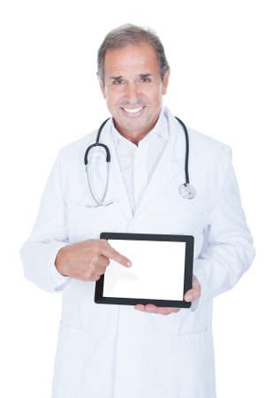 doctor computer: Mature Male Doctor Holding Digital Tablet On White Background