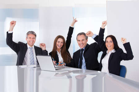 Portrait Of Happy Excited Businesspeople In Office photo