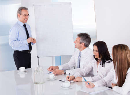 Businessman Discussing New Project With Colleagues In Office photo