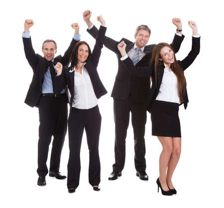 Happy Businesspeople Jumping In Joy Over White Background photo