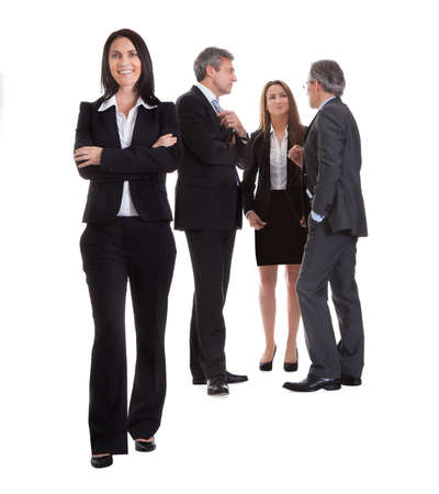 Businesswoman Standing In Front Of Her Colleagues Over White Background photo