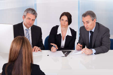 Group Of Businesspeople Interviewing Woman In Office photo