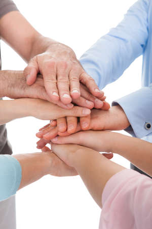 community support: Close-up Of Hand Stacked Over Each Other On White Background