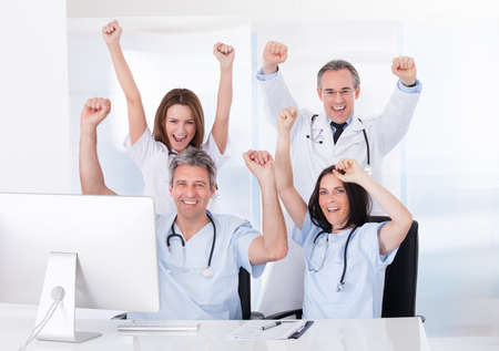 Group Of Happy Excited Doctor Raising Arm photo