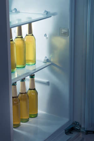kept: Bottles of alcoholic beer kept in a row