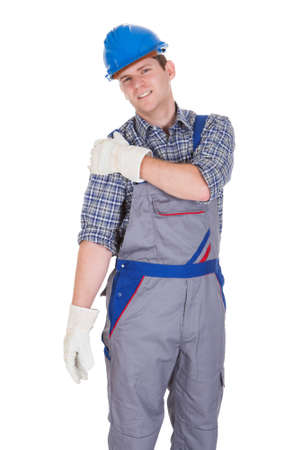 handglove: Male Worker Suffering from shoulder Pain isolated Over White Background