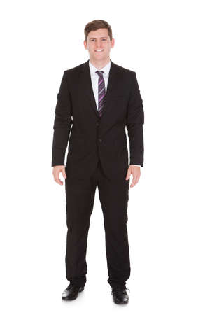 Portrait of happy businessman standing on white background photo