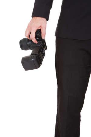 fashion photography: Closeup on hand holding camera on white background Stock Photo