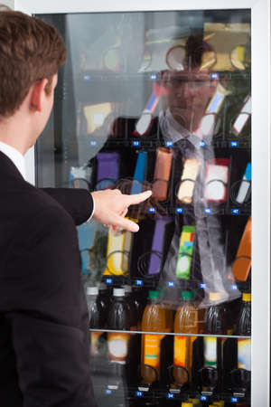 vending machine: Man pointing at chocolate in display cake