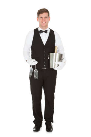 Waiter Holding A Wine Cooler With A Bottle Of Champagne And Champagne Glass photo