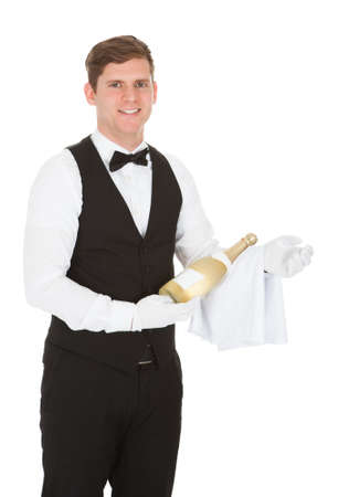 Waiter Holding A Champagne Bottle Isolated Over White Background photo