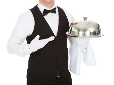 Waiter Holding Empty Silver Tray Over White Background photo