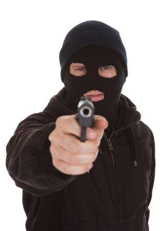 perpetrator: Burglar Wearing Mask Aiming Gun Towards Camera