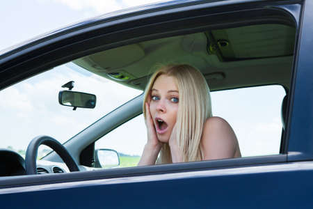 car trouble: Portrait Of Frustrated Woman Screaming Sitting In Car