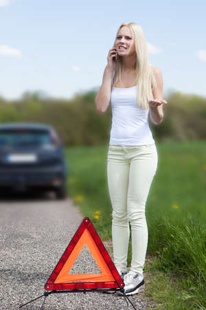 traffic accidents: Portrait Of Young Woman Calling For Help To Repair Car