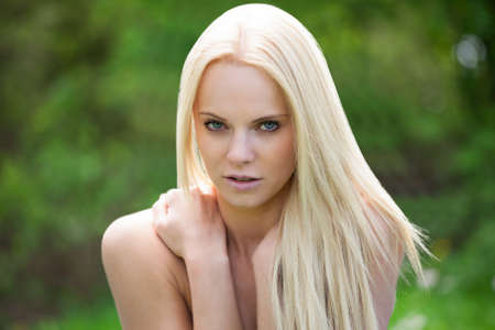 Portrait Of Young Topless Woman Relaxing In Nature Stockfoto