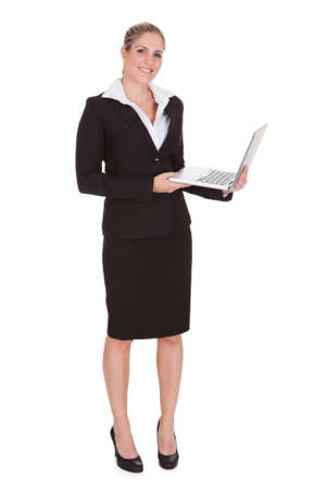 Portrait Of Happy Businesswoman Holding Laptop Over White Background Stock Photo - 21043915