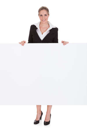 Happy Young Businesswoman Holding Empty Placard Over White Background Stock Photo - 21041178
