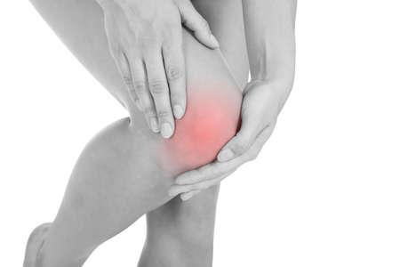arthritis pain: Close up of woman leg injury isolated on white background