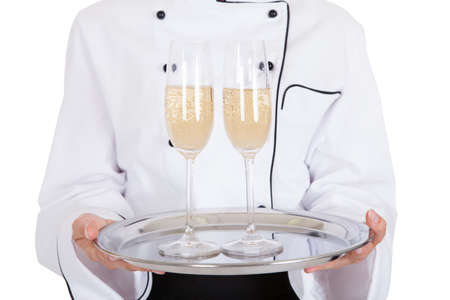 Portrait Of Female Chef Holding Champagne Over White Background Stock Photo - 21043866