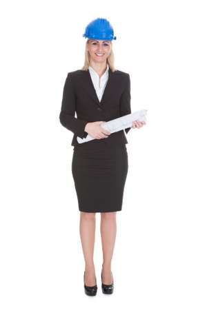 Portrait Of Happy Female Architect Holding Blueprint Over White Background Stock Photo - 21234470