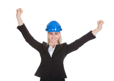 Portrait Of Excited Female Architect Holding Blueprint Over White Background Stock Photo - 21234473