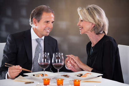 Romantic Couple Having Dinner At The Restaurant photo