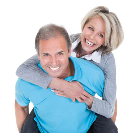 mature female: Mature Man Piggybacking His Happy Wife Over White Background