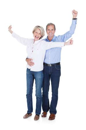 Happy Mature Lovely Couple Enjoying Success Isolated Over White Background photo