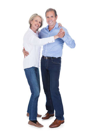 couple dancing: Happy Mature Couple Dancing Isolated Over White Background