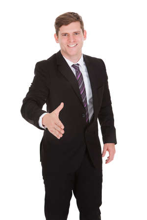 Happy businessman offering handshake isolated on white background photo
