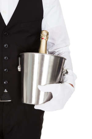Waiter Holding A Wine Cooler With A Bottle Of Champagne photo