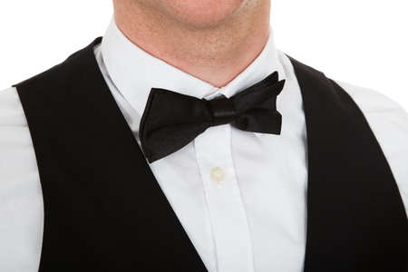 Close-up Of A Man Dressed In A Suit With Bow Tie Over White Background photo