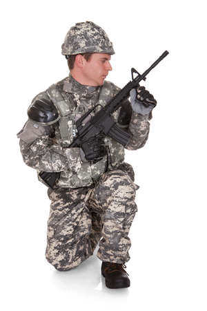 Close-up Of Solider Aiming At Direction Isolated Over White Background photo