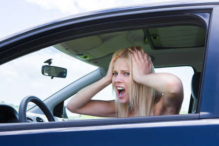 troubles: Portrait Of Frustrated Woman Screaming Sitting In Car