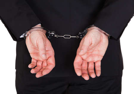 Rear view of arrested businessman with handcuffs Stock Photo - 21253819