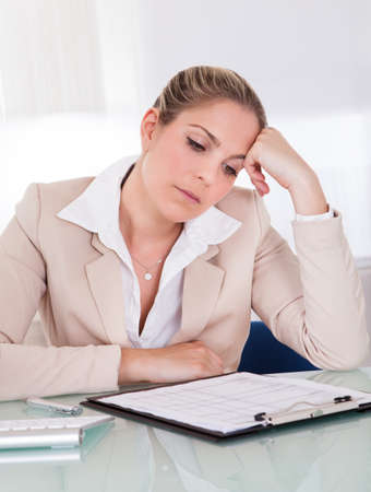 Stressful business woman working in the office photo