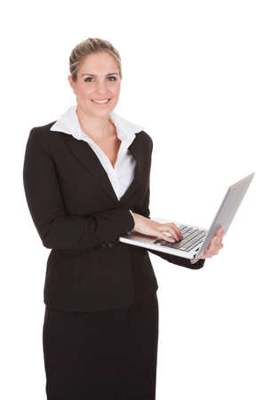 Portrait Of Happy Businesswoman Holding Laptop Over White Background Stock Photo - 21235207