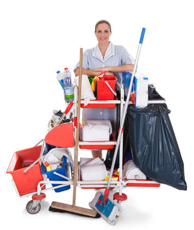 Female Cleaner With Cleaning Equipment Isolated On White Background photo