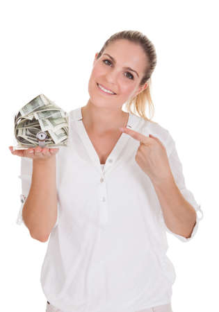 Young Woman Holding A Box Of Currency Over White Background photo