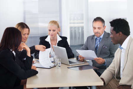 diverse women: Group Of Multi Ethnic Businesspeople Discussing Together In Office