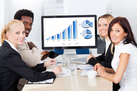 Group Of Multi Ethnic Businesspeople Discussing Together In Office photo