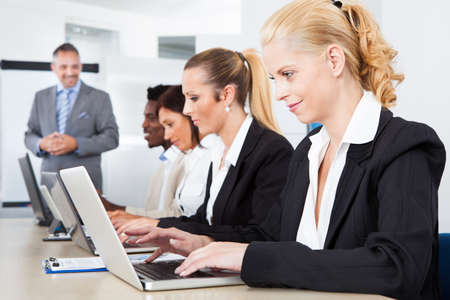 corporate group: Group Of Multi Ethnic Businesspeople Working Together In Office Stock Photo