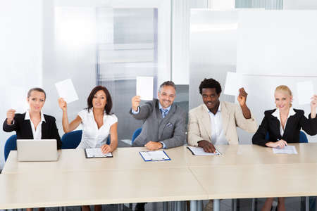 Group Of Happy Corporate Personnel Officers Holding Blank Paper photo
